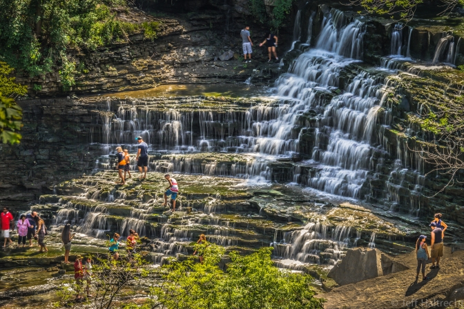 People cooling off in Albion Falls on a hot summer day