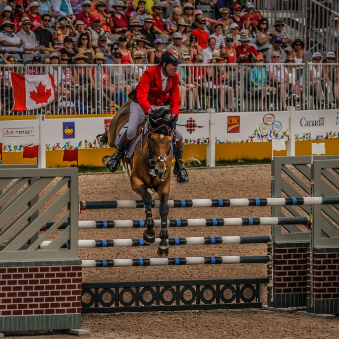 Ian Miller In Action:  Ten-time Olympian jumping Dixson at Pan Am Games