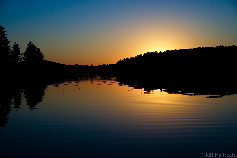 muskoka blue sunset with yellow fireball
