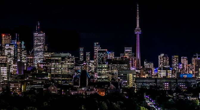 Sweeping night time view of Toronto's skyline, as seen from Park Hyatt rooftop lounge