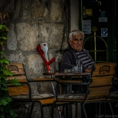 croatian man having coffee break at outdoor cafe