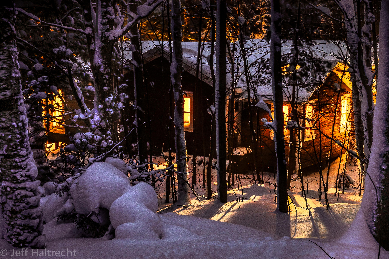 glowing muskoka cottage in a winter wonderland