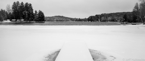 half frozen lake and snow at the baysville cottage