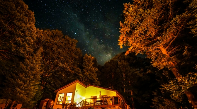 Milky Way seen rising over cottage on Bay Lake, Muskoka