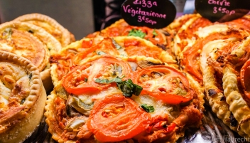 Food is better eaten than photographed, however this is one of those exceptions. On a walk through Paris' Marais district, we stopped in a charcuterie to buy some deli meat, and while being served, I saw this hand made artisan pizza that looked delicious. So I took the picture!