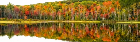 fall colors mirrored on echo lake, lake of bays township, muskoka, ontario, canada