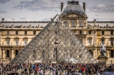 crowds of tourists at the louvre pyramid 673 panes of glass pei
