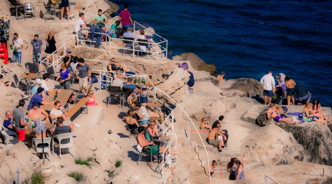 Tourists sunbathing on the rocks in 16th Century Dubrovnik, Croatia back in 2015